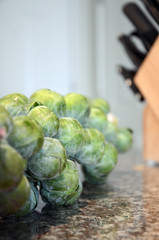 Off with their heads! (tao-of-m) Tags: brusselsprouts food vegetables raw knives countertop kitchen
