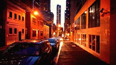 city windows people urban orange cars architecture night... (Photo: mugley on Flickr)