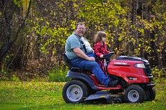 Driving Grandpa's Mower (Vegan Butterfly) Tags: family autumn people man fall kid child grandfather lawn grandpa granddaughter riding together mower