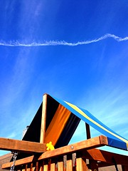 The Christmas Sky 1 (Cesar's iPhoneography) Tags: christmas xmas blue chimney sky rooftop lines yellow clouds backyard day texas suburban cloudy stripes suburbia houston bluesky diagonal powerlines wires streaks skyward pearland junglegym triangular iphoneography