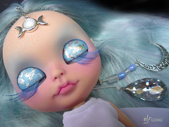 Luna has a glow in the dark pair of eyechips, glowing hairstrains and glittering moondust on her forehead