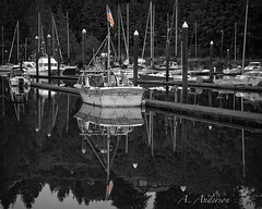 Sailing under US Flag (A Anderson Photography) Tags: reflections mono boat blackwhite flag