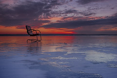Waiting for spring  (Explored 01/06/15) (wiltsepix) Tags: winter sunset lake ice chair michigan surreal dreaming explore higgins cloulds