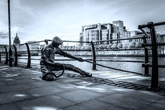 The Linesman (Carmel..) Tags: ireland sky sculpture dublin sunlight building art water sepia bronze clouds docks fence pavement shade ifsc railing customhouse cityquay linesman
