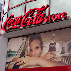 coca-cola store (what's_the_frequency) Tags: red girl sign canon store spring bottle model pretty cola lasvegas nevada ad coke advertisement storefront signage april thestrip soda cocacola thirst lasvegasboulevard refresh quench clarkcounty calnevari sx50hs