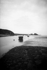 Bude Harbour (Justin Haynes Photography) Tags: uk longexposure greatbritain sea england cloud seascape 120 film beach water monochrome clouds analog landscape boats mono canal seaside sand rocks europe cornwall unitedkingdom harbour britain outdoor tripod pinhole le gb 6x9 noon springtime manfrotto breakwater 612 ilfordpanf bude justinhaynes justinhaynesphotography