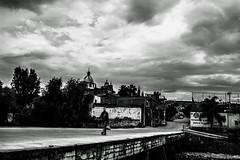 don't look back (Edwin M. Glez) Tags: sky blackandwhite woman clouds contrast canon way walking mexico town high walk dramatic jalisco himmel alon walker cielo nubes contraste keep figueroa kontrast ein weg gehen woken t3i somebody allein gabiel dramatisch dramatico inluencia