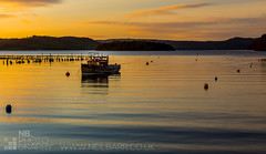 Sun up, at Balmaha Bay (GenerationX) Tags: longexposure blue sky white water yellow clouds sunrise reflections dawn islands bay scotland boat fishing waves unitedkingdom jetty scottish neil ripples loch lomond trossachs bouys barr balmaha