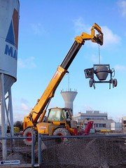 Was it a hanging matter ? (xavnco2) Tags: plant france building yellow jaune construction cement mixer equipment machinery tp chariot picardie chantier boves engin somme btonnire tlescopique