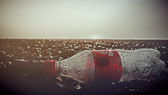 Cocensation (Mark.L.Sutherland) Tags: morning red beach stones shingles samsung litter shore rubbish portsmouth droplet condensation cocacola waterdroplets southsea