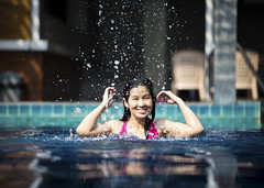 Girl in swimming pool (Bugphai ;-)) Tags: travel blue summer sunlight sports nature water pool smiling fashion female swimming asian fun thailand one healthy model women energy asia power exercise action joy tan resort human thai dreams tropical leisure activity relaxation fitness adults vacations sunbathing enjoyment pursuit swimwear lifestyles recreational