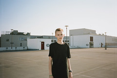 (Dominik Geiger) Tags: vienna boy portrait black film analog 35mm austria clothing day kodak parking indie