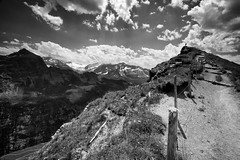 Above The Gental (nigelhunter) Tags: above sky mountain alps clouds fence landscape person switzerland path bernese oberland gental