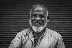 Portrait | Old Delhi (Syahrel Azha Hashim) Tags: nikon expression shallow holiday pc9 simple indian details india local blackandwhite dof action asia people olddelhi streetphotography 2015 vacation prime light humaninterest naturallight traditionalclothing handheld oneperson d300s travel syahrel 35mm rajasthan street getaway smiling moment happy detail