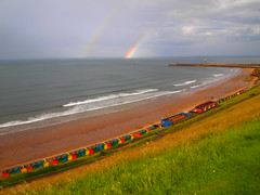 Clear Light over Whitby and the North Sea (cycle.nut66) Tags: blue red sea sky green beach yellow clouds four pier rainbow sand waves harbour north entrance olympus double huts whitby micro promenade thirds westcliff beacj rass epl1 mzuiiko