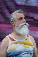 trying to blend in (mjwpix) Tags: cosimomatteini ritratto portrait beard graffiti moustache michaeljohnwhite mjwpix canoneos5dmarkiii ef135mmf2lusm tryingtoblendin