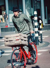 Fruit Basket (Rolling Spoke) Tags: bike bicycle bici bicicleta bicicletta bisiklet ciclismo fiets fahrrad velo street style fashion mens man basket crate wooden raincoat hat chic cycling ride red amsterdam fruit wheel outdoor deveuxjules
