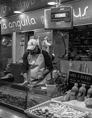 The Eel (Anguila) Man - Mercado Central - Valencia (BW) (Panasonic Lx100) (markdbaynham) Tags: street leica city urban bw white black valencia monochrome lens four lumix spain zoom market central panasonic espana mercado spanish espanol third fixed ft metropolis es 43rd compact lx mercat dmclx lx100 2475mm f1728 dmclx100