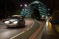 makeshift tripod, Lower Thames St, London (silabob) Tags: road city windows light shadow urban blur london architecture evening taxi nighttime lowerthamesstreet sigma35mmf14