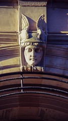 Valkyrie (elizunseelie) Tags: city winter light shadow urban sculpture woman sun sunlight building face statue stone architecture contrast scotland town carved high arch pentax glasgow helmet feathers scottish carving dslr valkyrie k5 verticle ipad 9x16 photoshopexpress snapseed