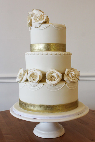 White with Gold Glitter Ribbon Wedding cake with White Sugar Roses