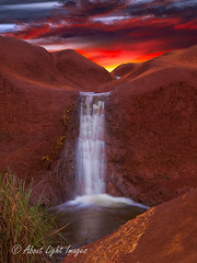 Red Rock Falls (About Light Images Photography) Tags: ocean sunset red rock hawaii landscapes seascapes waterfalls kauai waimeacanyon
