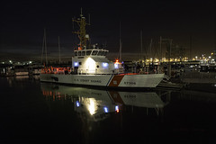 The Dorado @ Jack London Square (LifeLover4) Tags: uscgcdoradowpb87306 coastguard cutter docked oakland jacklondonsquare california night estuary reflections cranes portofoakland boat hughstickney stickneydesign