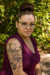 100 Strangers | 89: Brittany (Facundity) Tags: portrait newmexico vertical outdoors 50mm streetphotography albuquerque tattoos eyeglasses bun updo strangerportrait ef50mmf14usm newmexican outdoorportrait 100strangers 89100 canoneos70d