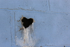 Destructive Love (leadyga) Tags: old blue white building brick love broken june canon outside outdoors graffiti break hole heart outdoor destruction crack adventure abandon rebelt5