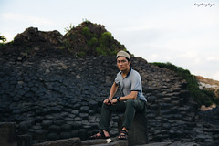 Tang Van Ngoc (langthangdaydo) Tags: life travel portrait people man black men green face rock stone contrast relax coast living cool nikon rocks asia stones lifestyle sigma vietnam human lonely traveling backpacker milestone milestones traveler sigma1750