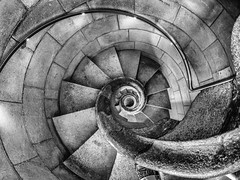 Going Down (derek.dpr) Tags: barcelona gaudi sagrada familia sagradafamilia stairs stairway staircase stairwell steps stonework stone spiral perspective bw black bianco nero noir monochrome mono olympus omd em5