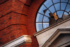 DSC_6319 [ps] - Puff & Bluster (Anyhoo) Tags: anyhoo photobyanyhoo holloway london england uk lowsun urban red brick manorgardens fragmentation reflection distortion arch pediment fanlight stone masonry facade faade stonework