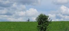 Alone (Elisa1880) Tags: clouds wolken meisje girl vrouw woman dijk dike boom tree fiets bike nederland netherlands nieuwerkerk aan den ijssel