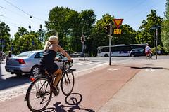 Summer Traffic (Jori Samonen) Tags: woman bicycle lane people car bus street intersection sign tree blue sky shadow kruununhaka siltavuorenranta unioninkatu helsinki finland sony ilce3000 e 1855mm f3556 oss sonyilce3000 e1855mmf3556oss