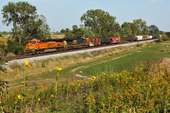 BNSF6270-0151 (Jim Thias) Tags: railroad flowers ohio train trains rails locomotive boxcar ge bnsf railroads csx freighttrain tankcar burlingtonnorthernsantafe 865 csxt 6270 bnsfrailway bloomdale es44ac coveredhopper