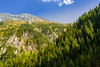 Rocks and evergreens (Raoul Pop) Tags: autumn trees sky mountains fall colors stone clouds canon austria rocks afternoon cliffs evergreen walls pinetrees krimml mountaintops osttirol canoneos5d at