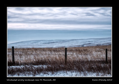 Windswept wintry landscape near Ft. MacLeod, Alberta - Happy Fence Friday (kgogrady) Tags: winter snow canada cold clouds fence landscape outside south noone ab nopeople alberta fujifilm grasses prairie fujinon barbedwirefence ois westerncanada hff 2015 southernalberta xt1 canadianlandscapes canadianprairies picturesofcanada photosofcanada albertalandscapes happyfencefriday xf55200mmf3548ois picturesofalberta photosofalberta fujifilmxt1