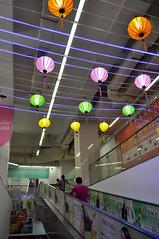 Lighting the way (Roving I) Tags: tourism vertical retail shopping decoration malls vietnam escalators decor danang lottemart entrances chineselanterns