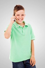Happy little boy talking on the phone, isolated on white backgro (khanov2007) Tags: life boy portrait people white cute male men green beautiful smile face childhood smiling mobile youth mouth studio fun happy person kid funny call technology child phone little sweet expression background telephone small joy young adorable handsome talk communication teen human attractive teenager conversation cheerful receiver isolated caucasian