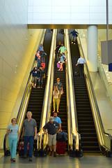 Travelers at rest (radargeek) Tags: travel travelers airport dfw dallasfortworth escalator