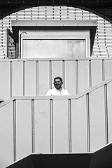 a man (Berkan Byktmbk) Tags: street streetphotography streetphoto fujifilm xt1 bw blackandwhite monochrome stairs bridge man human window outdoor
