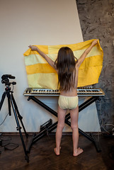 Yellow Sonya Playing Keyboard (Kontramax) Tags: music baby playing girl yellow stand kid holding keyboard key play pants action geometry tripod daughter young indoor cloth staying manfrotto keyb
