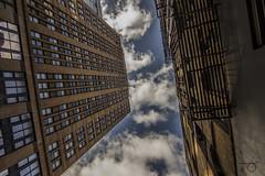 Clouds (Derek Mindler) Tags: street new york nyc blue windows sky newyork reflection film glass beautiful look buildings dark fire cool intense pretty escape skyscrapers angle manhattan grain wide sharp tokina touching 1116mm