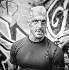 Dimitri (pjr100) Tags: portrait blackandwhite bw man film tongue rolleiflex pose body tmax tattoos 400 split modification maodel