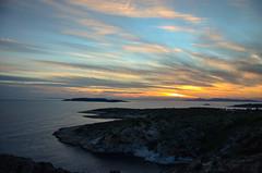 Hunting the sunset (kutruvis nick) Tags: sunset sea sky sun water clouds landscape greek islands coast nikon hunting hellas rocky greece nik attiki varkiza d5100 kutruvis