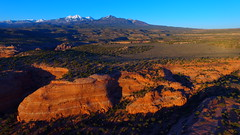 Southern Utah Splendor 6 (Dan Beland) Tags: trees sunset cliff usa mountains art nature rock forest landscape utah unmodified spring unitedstates desert artistic outdoor bluesky canyon erosion vista northamerica redrocks rockymountains southernutah springtime rockformations unedited rockformation drone snowcappedmountains moabutah nofilters noadjustments dji straightoffthecamera lasaljunction quadcopter phantom3professional