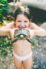 Cute little girl holding a turtle (PrgomeljaDusanAna) Tags: life summer portrait pet brown white cute green eye nature girl beautiful beauty smile face look childhood animal hair studio fun happy person kid healthy holding toddler funny child hand looking little action head turtle expression reptile background small tortoise young shell lifestyle happiness human enjoy environment lovely isolated
