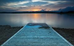Pasarela (Alfredo.Ruiz) Tags: sunset lake nature clouds landscape spain ray footbridge