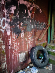 A Beautiful Mess in Brooklyn (squeex) Tags: door newyork abandoned brooklyn graffiti garbage dumbo tire