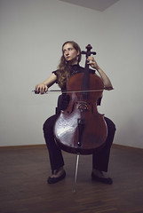 Cellist paying solo (@bythetallone) Tags: cellist cello musician music portrait people studio moody